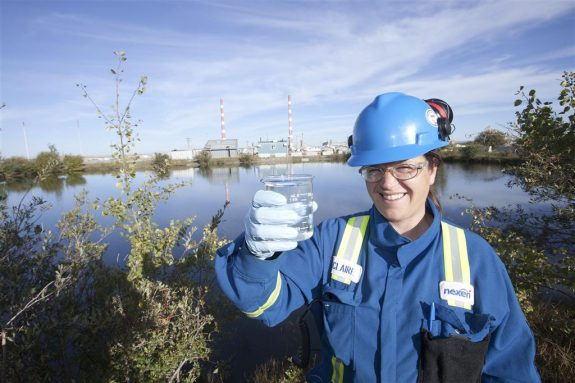 Worker testing water on a reclamation site