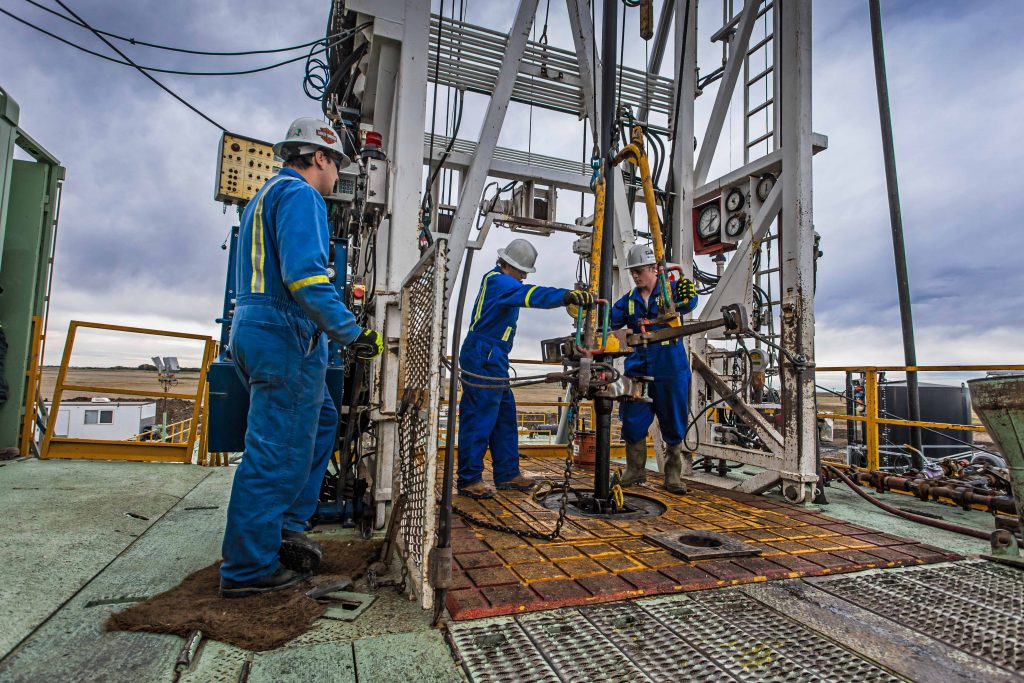 Workers on a drilling rig